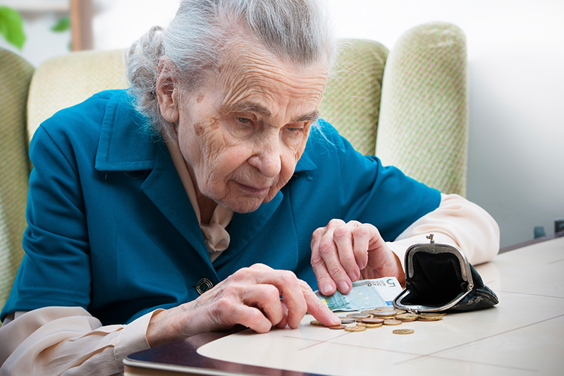 Older woman counting change from her wallet